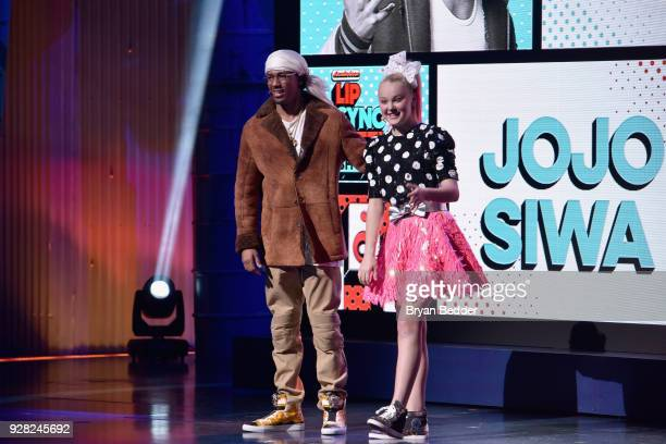 Nick Cannon and JoJo Siwa speak onstage at the Nickelodeon Upfront 2018 at Palace Theatre on March 6 2018 in New York City