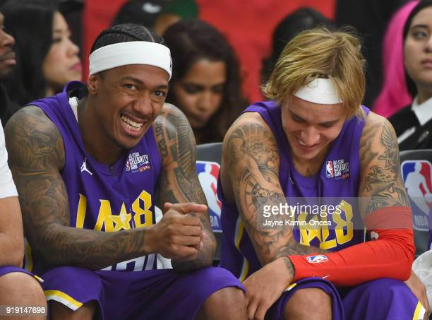 Nick Cannon and Justin Bieber on the bench during the 2018 NBA AllStar Game Celebrity Game at Los Angeles Convention Center on February 16 2018 in...