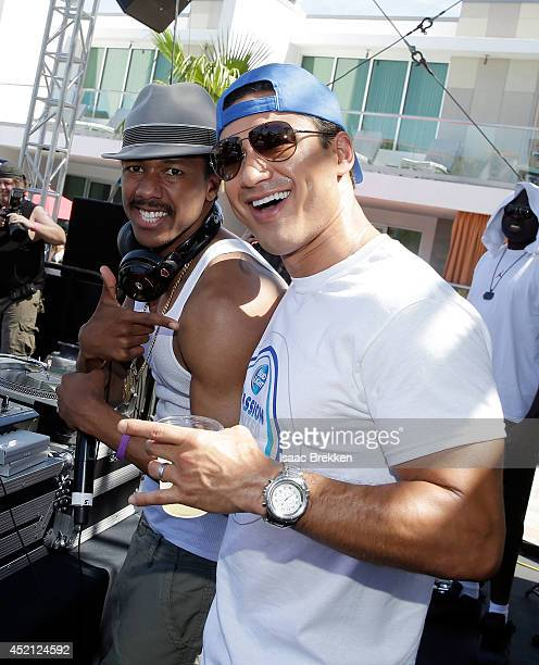 Nick Cannon and Mario Lopez attend Bud Light's ultimate FIFA World Cup viewing party on July 13 2014 in Las Vegas Nevada