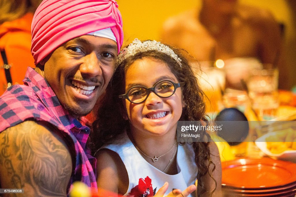 Nick Cannon (L) and Monroe Cannon celebrate the twins birthday at Disneyland on April 30, 2017 in Anaheim, California.