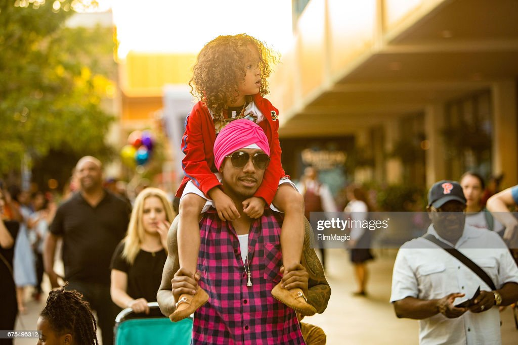 Nick Cannon and Moroccan Cannon visit Disneyland on April 30, 2017 in Anaheim, California.