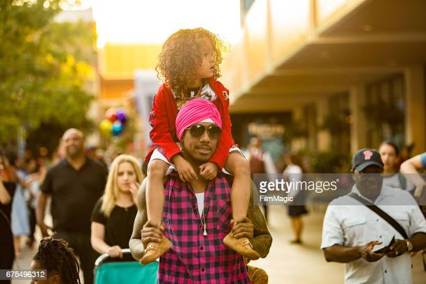 Nick Cannon and Moroccan Cannon visit Disneyland on April 30 2017 in Anaheim California