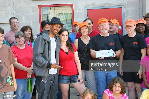 Nick Cannon and Nicole Fredman present a check for ten thousand dollars to Jim Glynn the Executive Director of Metro Lutheran Ministry at the...