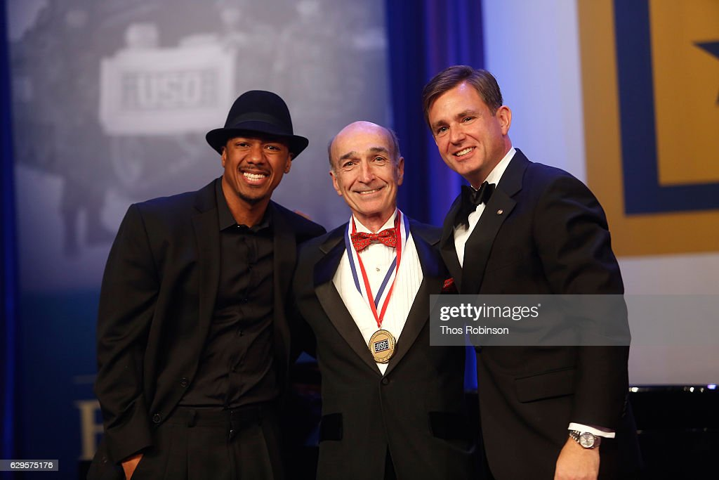Nick Cannon and President & CEO, USO of Metropolitan New York Brian Whiting present an award onstage at the USO 75th Anniversary Armed Forces Gala & Gold Medal Dinner at Marriott Marquis Times Square on December 13, 2016 in New York City.