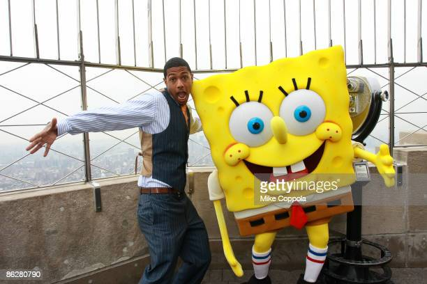 Nick Cannon and the SpongeBob SquarePants character visit the Empire State Building to power down for Earth Day on April 22 2009 in New York City