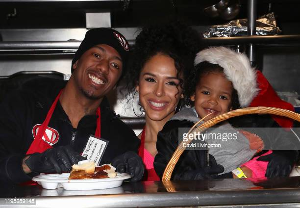 Nick Cannon, Brittany Bell and their son Golden Cannon attend Christmas Celebration On Skid Row at the Los Angeles Mission on December 23, 2019 in...