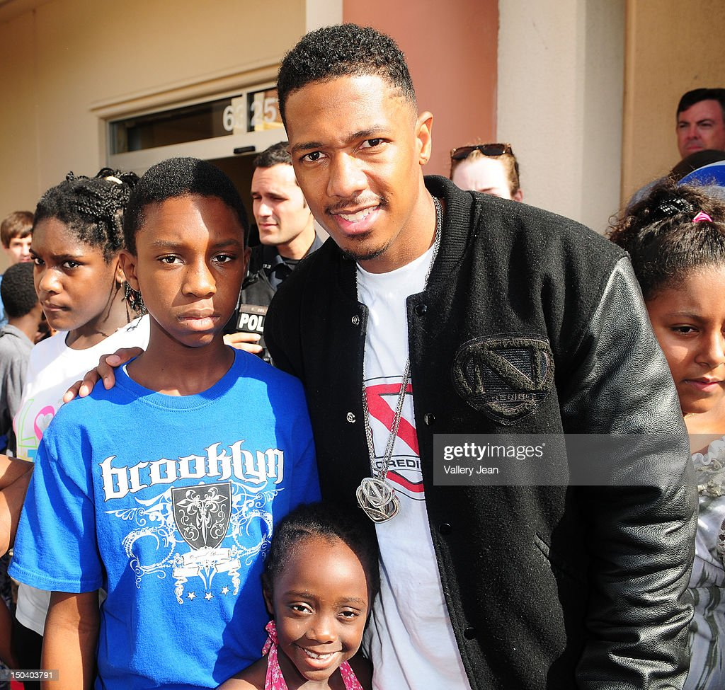 Nick Cannon Donates Backpacks To Kids In Need Photos and Images ...