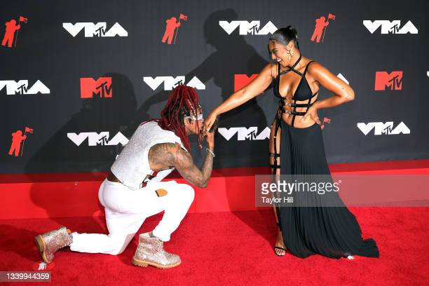 Nick Cannon greets Ashanti at the 2021 MTV Video Music Awards at Barclays Center on September 12, 2021 in the Brooklyn borough of New York City.
