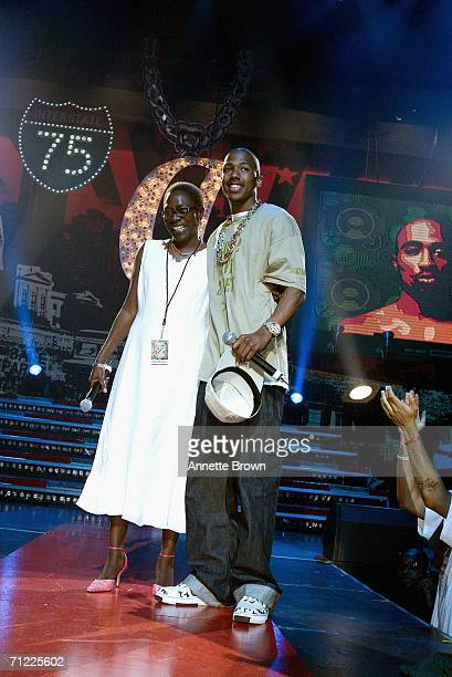 Nick Cannon introduces Tupac Shakur's mother Afeni Shakur during a tribute to her son at the Boost Mobile Rockcorps Volunteers Concert at Fox Theater...