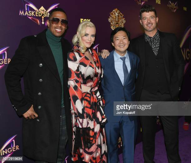 Nick Cannon Jenny McCarthy Ken Jeong and Robin Thicke attend Fox's The Masked Singer Premiere Karaoke Event at The Peppermint Club on December 13...
