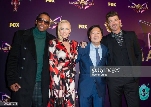 Nick Cannon Jenny McCarthy Ken Jeong and Robin Thicke attend Fox's 'The Masked Singer' Premiere Karaoke Event at The Peppermint Club on December 13...