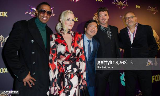 Nick Cannon Jenny McCarthy Ken Jeong Robin Thicke and executive producer Craig Plestis attend Fox's 'The Masked Singer' Premiere Karaoke Event at The...