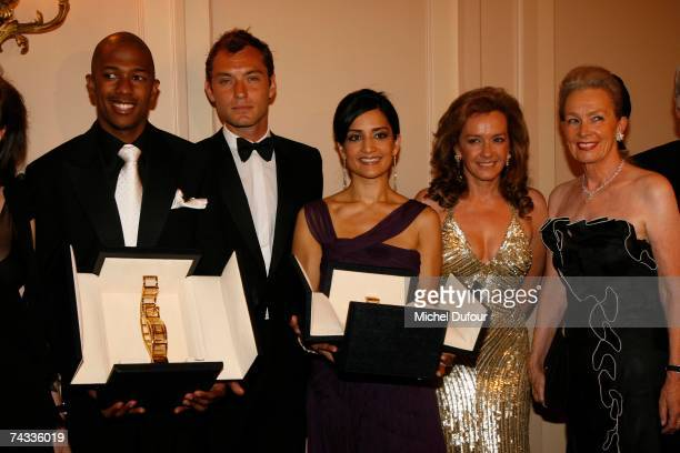 Nick Cannon Jude Law Archie Penjab Caroline Scheufele and her mother attends at the Chopard Trophy party in hotel Carlton on May 25 2007 in Cannes...