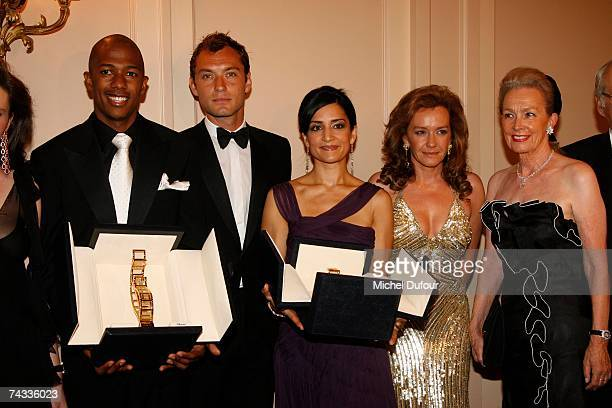Nick Cannon Jude Law Archie Penjabi Caroline Scheufele and her mother attends at the Chopard Trophy party in hotel Carlton on May 25 2007 in Cannes...