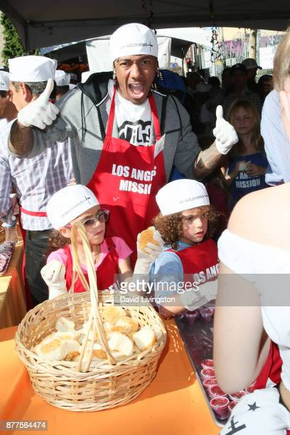 Nick Cannon Monroe Cannon and Moroccan Scott Cannon are seen at the Los Angeles Mission Thanksgiving Meal for the homeless at the Los Angeles Mission...