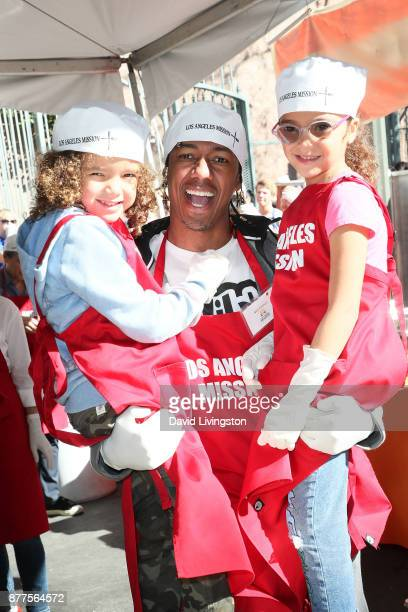 Nick Cannon Moroccan Scott Cannon and Monroe Cannon are seen at the Los Angeles Mission Thanksgiving Meal for the homeless at the Los Angeles Mission...