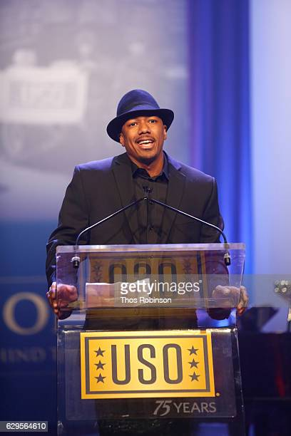 Nick Cannon speaks onstage the USO 75th Anniversary Armed Forces Gala Gold Medal Dinner at Marriott Marquis Times Square on December 13 2016 in New...