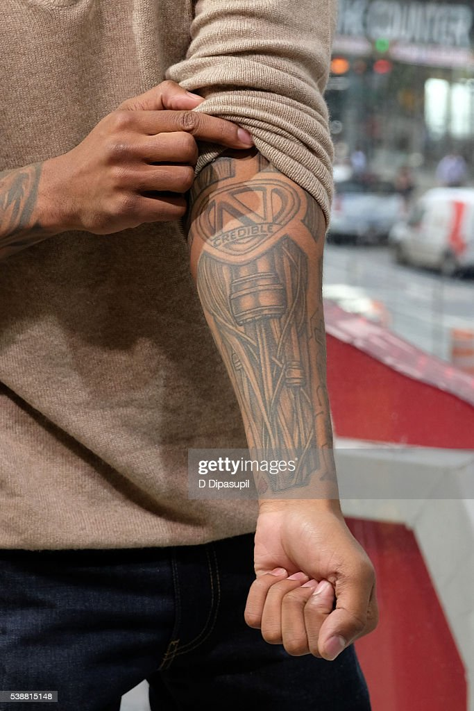 Nick Cannon, tattoo detail, visits