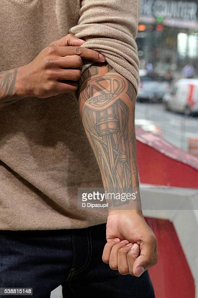 Nick cannon tattoo stock photos and pictures getty images for Square city tattoo