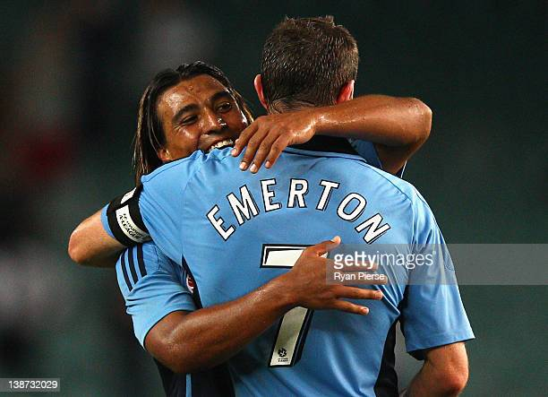 Nick Carle and Brett Emerton of Sydney celebrate after during the round 19 A-League match between Sydney FC and Perth Glory at Sydney Football...
