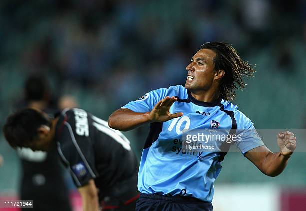 Nick Carle of Sydney celebrates after scoring his teams first goal during the group H ACF Champions League match between Sydney FC and Shanghai...