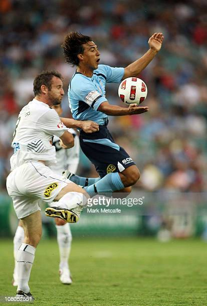 Nick Carle of Sydney is challenged by Grant Brebner of Victory during the round 23 ALeague match between Sydney FC and the Melbourne Victory at...