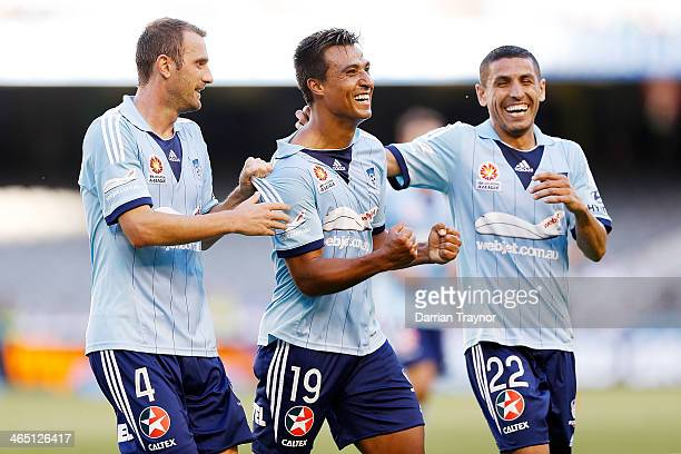 Nick Carle of Sydney is congratulated by team mates Ranko Despotovic and Ali Abbas after scoring a goal during the round 16 ALeague match between...
