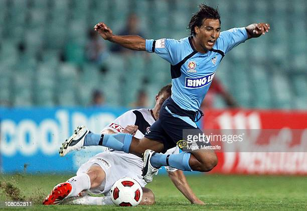 Nick Carle of Sydney is tackled by Danny Allsopp of Victory during the round 23 ALeague match between Sydney FC and the Melbourne Victory at Sydney...