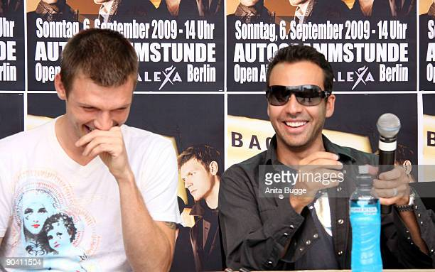 Nick Carter and Howie Dorough of the Backstreet Boys attend a autograph session on September 6, 2009 in Berlin, Germany.