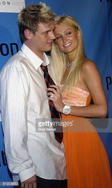 Nick Carter and Paris Hilton arrive for the release of the S Carter Tennis shoe party at the Playstation 2 Estate on July 3 2004 in South Hampton New...