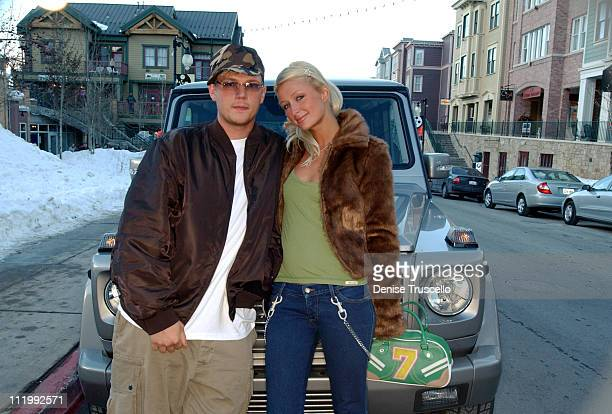 Nick Carter and Paris Hilton in front of the Mercedes G Wagon