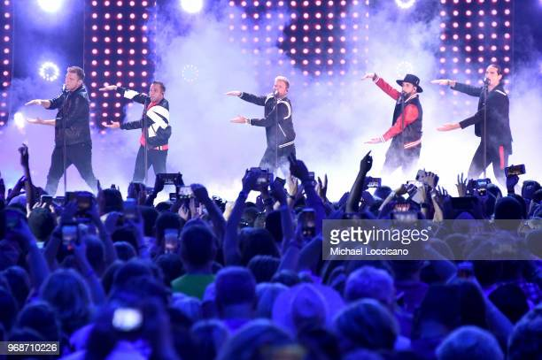 Nick Carter Howie Dorough Brian Littrell AJ McLean and Kevin Richardson of band the Backstreet Boys perform onstage at the 2018 CMT Music Awards at...