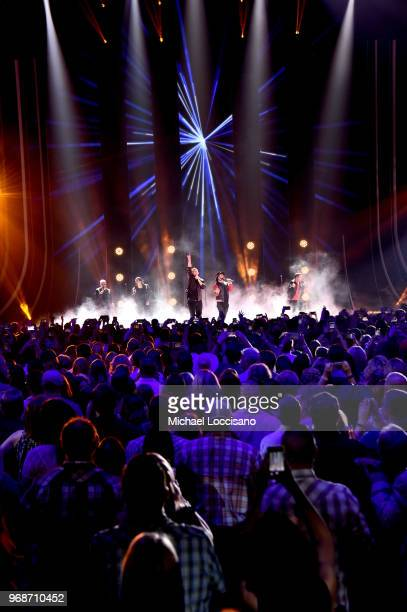 Nick Carter Howie Dorough Brian Littrell AJ McLean and Kevin Richardson of Backstreet Boys perform onstage at the 2018 CMT Music Awards at...