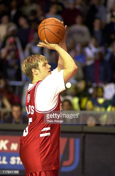 Nick Carter of Backstreet Boys takes a foul shot during MTV's Rock 'N Jock NBA AllStar Jam at Philadelphia Convention Center in Philadelphia...