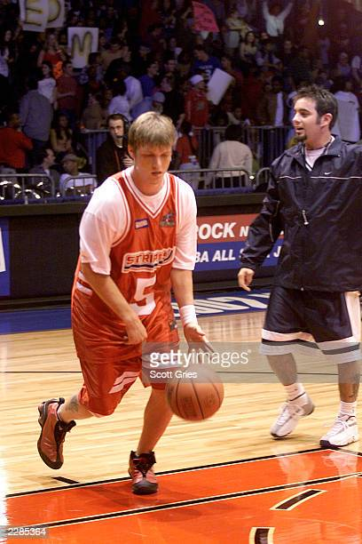 Nick Carter of The Backstreet Boys and Chris Kirkpatrick of N'Sync during MTV's Rock N Jock NBA All Star Jam at the Pennsylvania Convention Center in...