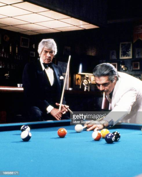 Nick Casey played by James Coburn and the Deacon played by Omar Sharif at a pool table in a scene from 'The Baltimore Bullet' directed by Robert...
