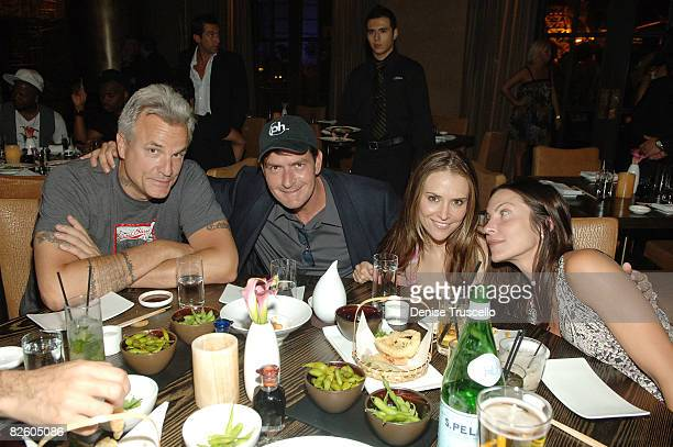 Nick Cassavetes, Charlie Sheen, Brooke Sheen and Heather Wahlquist attend the grand opening celebration of Yellowtail Sushi Restaurant & Bar At...