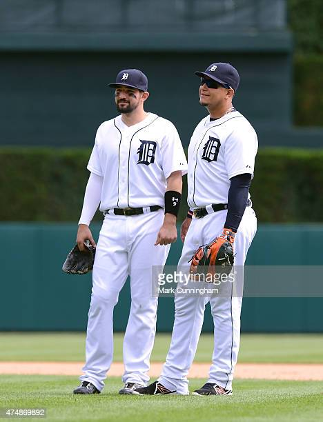 Nick Castellanos and Miguel Cabrera of the Detroit Tigers stand together on the field during the game against the Houston Astros at Comerica Park on...