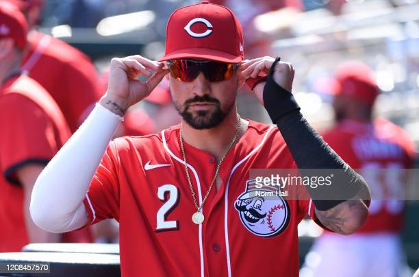 Nick Castellanos of the Cincinnati Reds prepares for a spring training game against the Texas Rangers at Goodyear Ballpark on February 24 2020 in...
