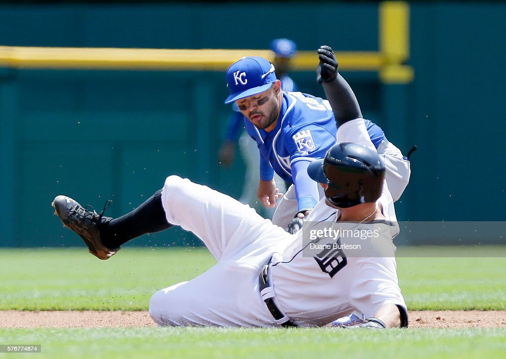 Nick Castellanos #9 of the Detroit Tigers beats the tag from second baseman Christian Colon #24 of the Kansas City Royals to stretch a hit into a double during the second inning at Comerica Park on July 17, 2016 in Detroit, Michigan.