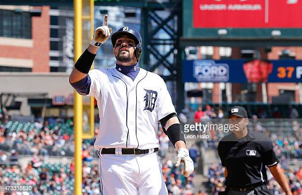 Nick Castellanos of the Detroit Tigers celebrates after hitting a solo home run in the fifth inning during the game against the Minnesota Twins on...