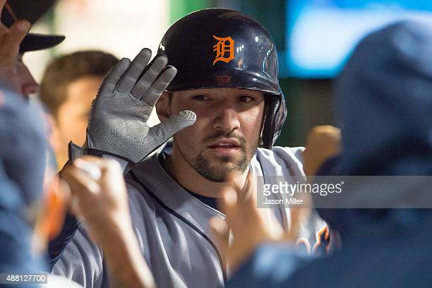 Nick Castellanos of the Detroit Tigers celebrates with teammates after scoring during the seventh inning against the Cleveland Indians during game...