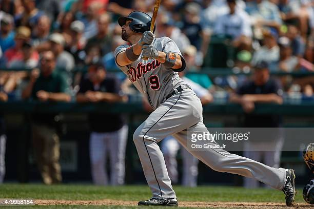 Nick Castellanos of the Detroit Tigers hits an RBI sacrifice fly against the Seattle Mariners in the seventh inning at Safeco Field on July 8 2015 in...