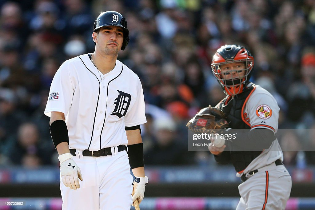 Nick Castellanos #9 of the Detroit Tigers reacts as he strikes out to end the fourth inning as Nick Hundley #40 of the Baltimore Orioles looks on during Game Three of the American League Division Series at Comerica Park on October 5, 2014 in Detroit, Michigan.