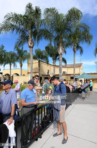Nick Castellanos of the Detroit Tigers signs autographs for fans outside of Joker Marchant Stadium after a Spring Training workout day on February 17...