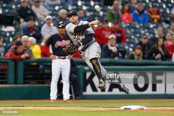 Nick Castellanos of the Detroit Tigers throws out Francisco Lindor of the Cleveland Indians at first base to end the eighth inning at Progressive...