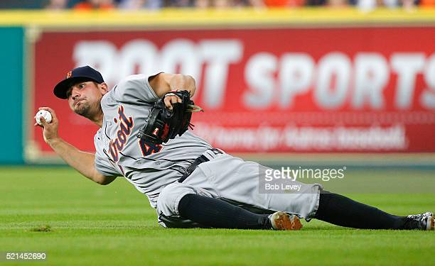 Nick Castellanos of the Detroit Tigers throws to first base in the third inning at Minute Maid Park on April 15 2016 in Houston Texas Colby Rasmus of...