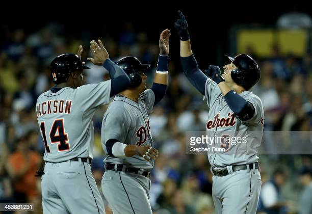 Nick Castellanos Victor Martinez and Austin Jackson of the Detroit Tigers celebrate after all three score on Castellanos' three run home run in the...