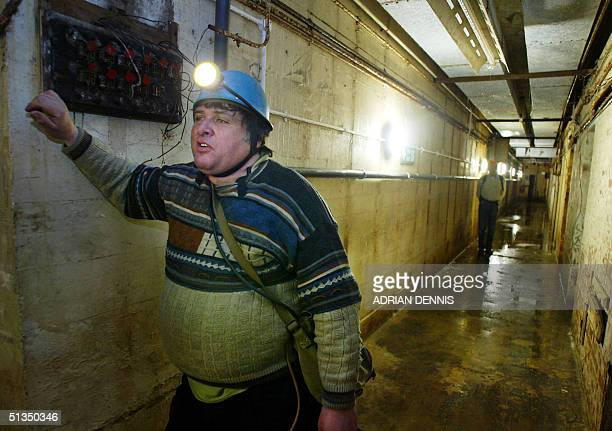 Nick Catford a member of Subterranea Britannica, inside a secret Second World War underground bunker in Neasden, west London 16 April 2002. The...