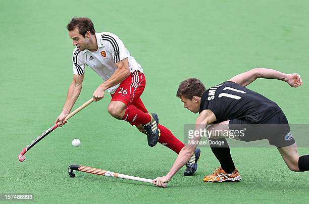 Nick Catlin of England controls the ball past Jacob Smith of New Zealand in the match between England and New Zealand during day three of the...